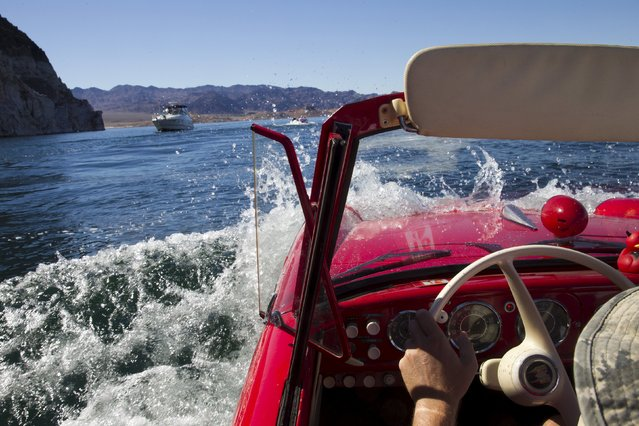 James Spear of Henderson operates a 1964 Amphicar 770 during the first Las Vegas Amphicar Swim-in at Lake Mead near Las Vegas, Nevada October 9, 2015. (Photo by Steve Marcus/Reuters)