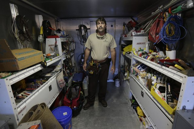 Former Cuban rafter Carlos Hernandez, 45, poses in his workshop in Miami September 18, 2014. Hernandez said he was a youth baseball star in Cuba when he decided to climb into a catamaran in 1994 and head for the U.S. (Photo by Rolando Pujol Rodriguez/Reuters)