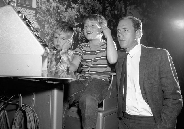 "Ronny Howard, center, who plays Opie on ""The Andy Griffith Show"", is joined by his real-life father Rance Howard and little brother Clint in an episode of the show, marking the first time that all three Howards had worked in a TV show together, in 1963. (Photo by AP Photo)"