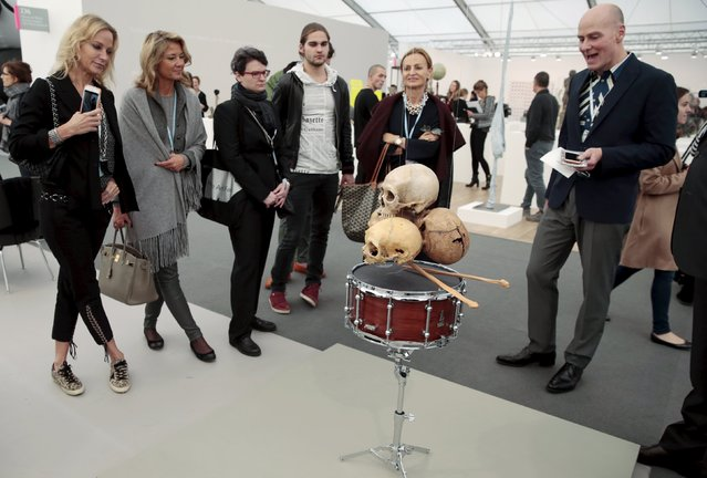 "Visitors look at ""Still life in the Doldrums (d'apres Cezanne)"" by Anri Sala at the Frieze Art Fair in London, Britain October 14, 2015. (Photo by Suzanne Plunkett/Reuters)"