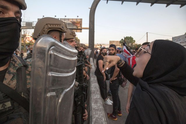 Anti-government protesters argue with security forces during a march toward the Presidential Palace, on September 12, 2020 in Baabda, Beirut, Lebanon. (Photo by Sam Tarling/Getty Images)