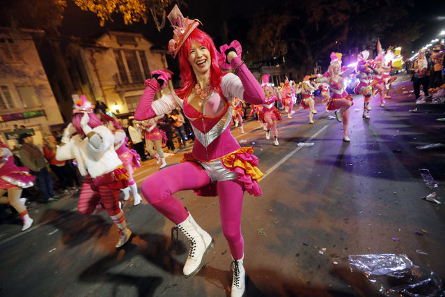 Members of the Pussyfooters dance at the Krewe of Cleopatra Mardi Gras parade in New Orleans, Friday, February 2, 2018. Mardi Gras season is kicking into high gear with a slew of major parades throughout New Orleans. Although Carnival season officially began Jan. 6, the festivities really kick into high gear the two weekends ahead of Fat Tuesday. This year Fat Tuesday is Feb. 13. (Photo by Gerald Herbert/AP Photo)