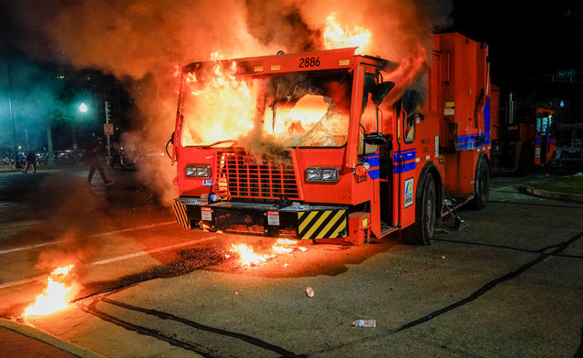 A city garbage truck burns during a second night of unrest in the wake of the shooting of Jacob Blake by police officers, in Kenosha, Wisconsin, USA, 24 August 2020. According to media reports Jacob Blake, a black man, was shot by a Kenosha police officer or officers responding to a domestic distubance call on 23 August, setting off protests and unrest. Blake was taken by air ambulance to a Milwaukee, Wisconsin hospital and protests started after a video of the incident was posted on social media. (Photo by Tannen Maury/EPA/EFE)
