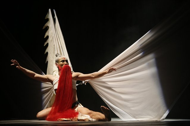 A dancer of the China Beijing Modern Dance Company performs in Midnight Rain at the University of Malta's theatre in Msida, outside Valletta, November 22, 2014. (Photo by Darrin Zammit Lupi/Reuters)