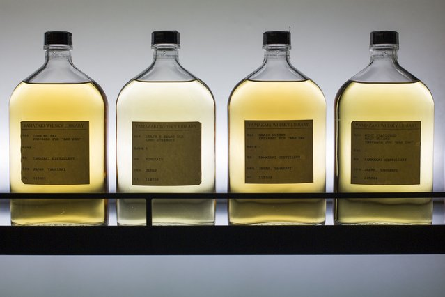Various samples of whisky are seen in the whisky library of Suntory Holdings' Yamazaki Distillery in Shimamoto town, Osaka prefecture, near Kyoto, December 1, 2014. (Photo by Thomas Peter/Reuters)