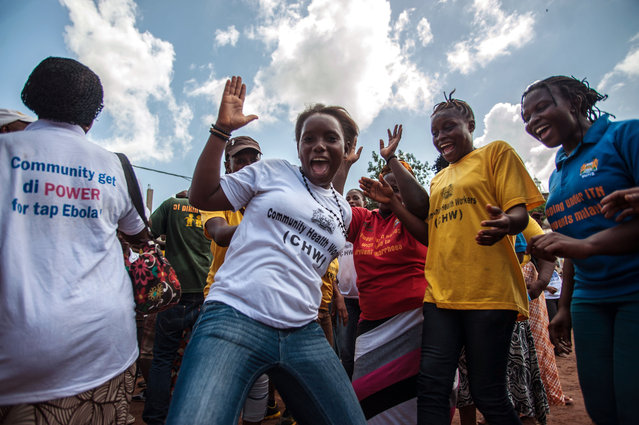 Women celebrate as their country is declared Ebola free in the city of Freetown Sierra Leone, Saturday, November 7,  2015. The World Health Organization declared Sierra Leone free from Ebola transmissions on Saturday, as West Africa battles to stamp out the deadly virus that is holding on in neighboring Guinea. (Photo by Aurelie Marrier d'Unienvil/AP Photo)