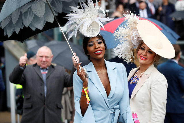 Racegoers during Ladies Day at the Grand National Festival at Aintree Racecourse on April 13, 2018 in Liverpool, England. (Photo by Jason Cairnduff/Reuters/Action Images)