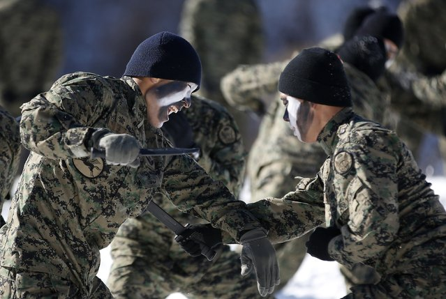 Members of the South Korean Special Warfare Forces holding combat knives take part in a winter exercise in Pyeongchang January 8, 2015. (Photo by Kim Hong-Ji/Reuters)