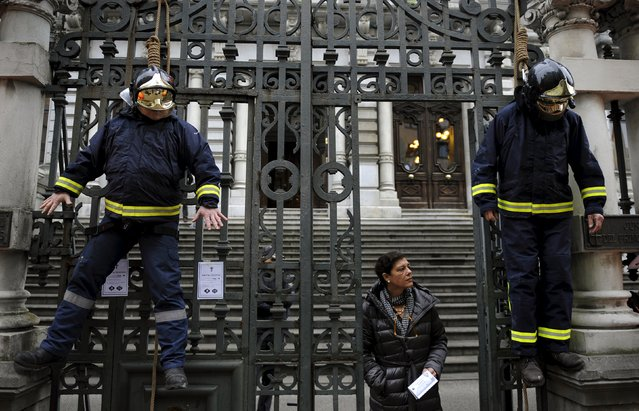 Firefighters take part in a protest in front of the regional parliament of Asturias to demand better organization and more staff in Oviedo, northern Spain, November 26, 2015. (Photo by Eloy Alonso/Reuters)