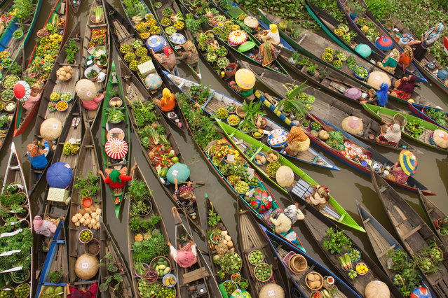 """""""Floating market, Malaysia"""". Water transportation plays an important role in everyday life in South Borneo. Third place: Travel. (Photo by Antonius Andre Tjiu/SIPA Contest)"""