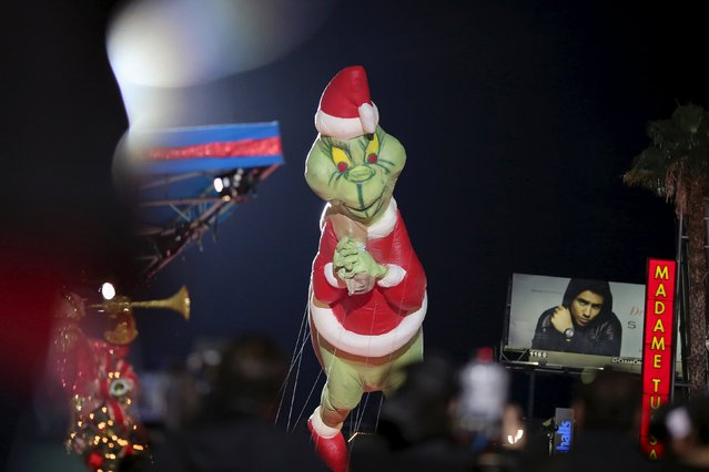 A Dr. Seuss The Grinch balloon appears in the 84th Annual Hollywood Christmas Parade in the Hollywood section of Los Angeles, California, November 29, 2015. (Photo by David McNew/Reuters)