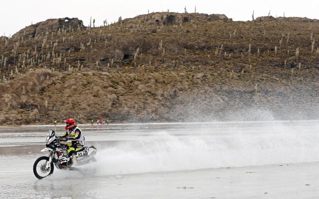 KTM rider Miran Stanovnik of Slovenia rides during the 8th stage of the Dakar Rally 2015 on the Salar de Uyuni salt flat, from Uyuni to Iquique, January 12, 2015. (Photo by Jean-Paul Pelissier/Reuters)