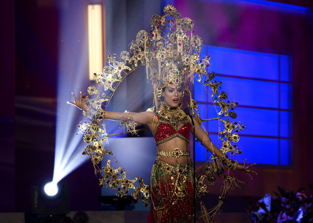 Miss India, Noyonita Lodh, poses for the judges, during the national costume show during the 63rd annual Miss Universe Competition in Miami, Fla., Wednesday, January 21, 2015. (Photo by J. Pat Carter/AP Photo)