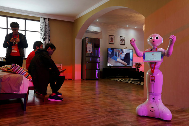 A robot demonstrates a smart home system inside an exhibition venue during Alibaba Group's 11.11 Singles' Day global shopping festival in Shenzhen, China November 11, 2016. (Photo by Bobby Yip/Reuters)
