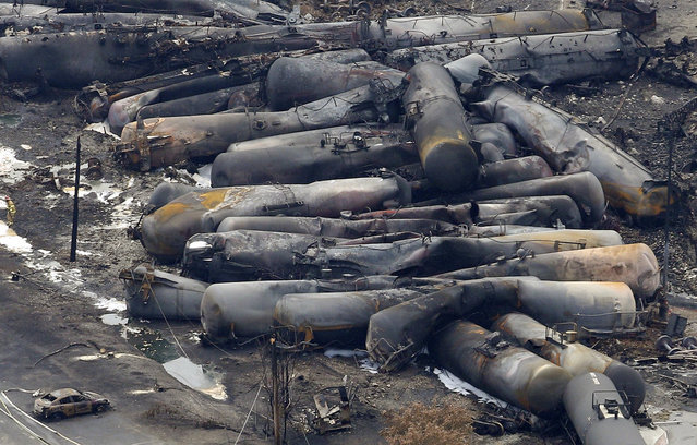 The remains of a burnt train are seen in Lac Megantic, July 8, 2013. (Photo by Mathieu Belanger/Reuters)