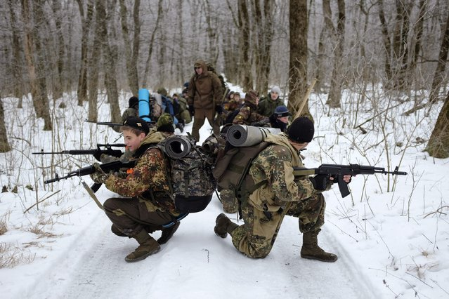 Students from the General Yermolov Cadet School take part in a field exercise outside the south Russian city of Stavropol January 25, 2015. (Photo by Eduard Korniyenko/Reuters)