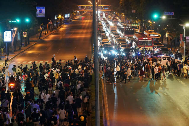 A general view as pro-democracy protesters cross a street during a rally demanding the prime minister to resign and reforms on the monarchy, in Bangkok, Thailand, February 10, 2021. (Photo by Athit Perawongmetha/Reuters)