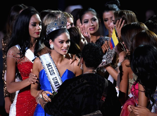 Miss Philippines 2015, Pia Alonzo Wurtzbach (2nd L), who was mistakenly named as First Runner-up reacts with other contestants after being named the 2015 Miss Universe during the 2015 Miss Universe Pageant at The Axis at Planet Hollywood Resort & Casino on December 20, 2015 in Las Vegas, Nevada. (Photo by Ethan Miller/Getty Images)