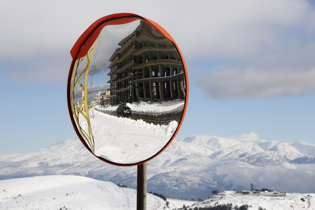A mirror reflects a driving car amid snow in Martaba village near the Lebanese-Israeli border, in south Lebanon January 11, 2015. (Photo by Aziz Taher/Reuters)