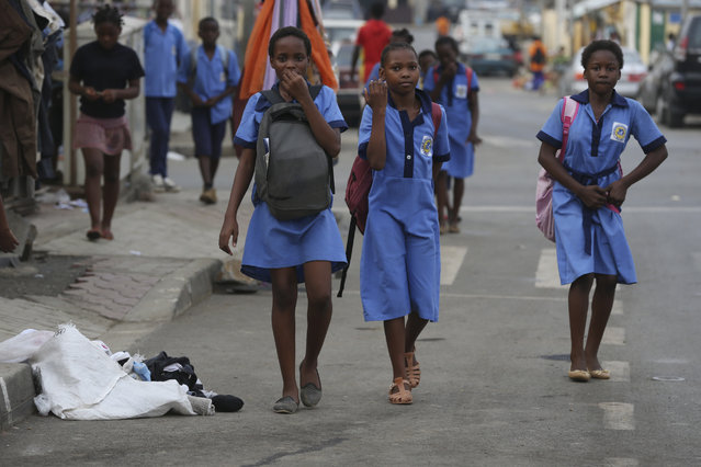 School children walk on the streets at Mene Ela neighborhood, in Malabo, Equatorial Guinea, Monday February 2, 2015. Malabo is holding the African Cup of Nations semifinal match on Thursday between Ghana and Equatorial Guinea at Estadio De Malabo. (Photo by Sunday Alamba/AP Photo)