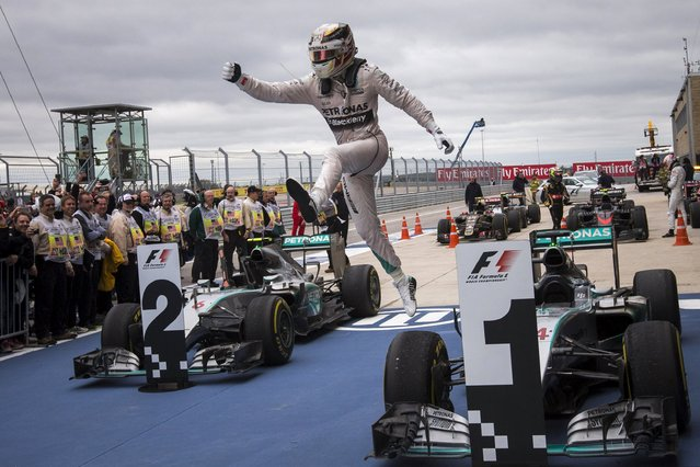 Mercedes Formula One driver Lewis Hamilton of Britain leaps off his car after winning the U.S. F1 Grand Prix at the Circuit of The Americas in Austin, Texas, United States, October 25, 2015. (Photo by Adrees Latif/Reuters)