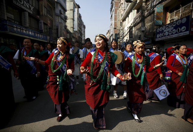 Gurung girls wearing traditional costumes dance while taking part in a New Year parade in Kathmandu, Nepal December 30, 2015. Members of the Gurung community in Nepal celebrate their Tamu Lhosar or Losar (New Year) with a feast and various cultural programs to usher in the year of the Monkey. (Photo by Navesh Chitrakar/Reuters)