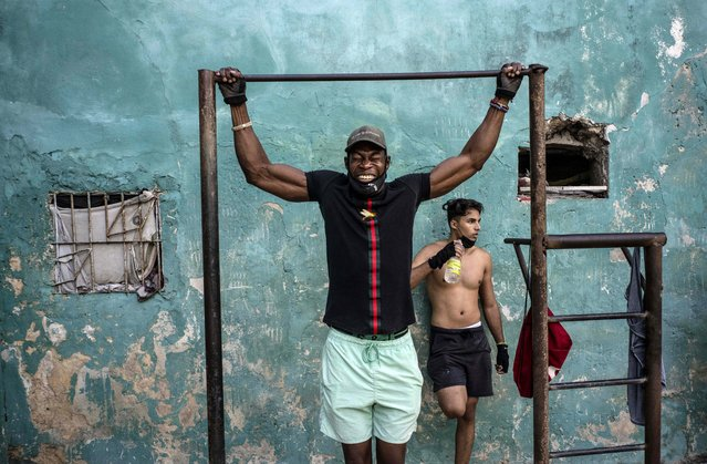 A man does pull ups amid the new coronavirus pandemic at a street gym in Havana, Cuba, Monday, December 21, 2020. (Photo by Ramon Espinosa/AP Photo)