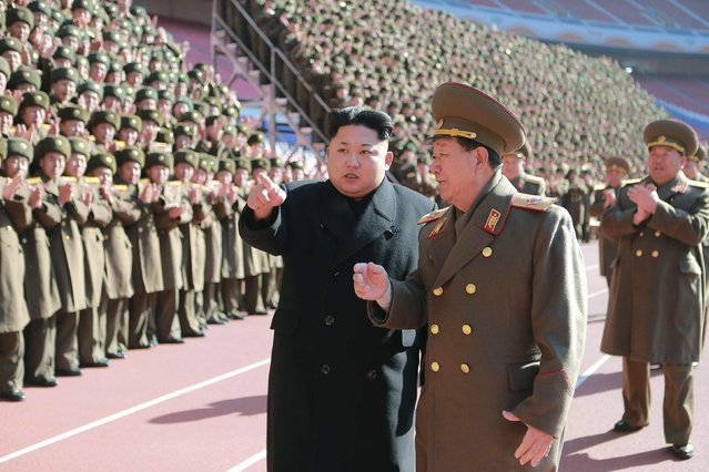 North Korean leader Kim Jong-un (C) gestures during a photo session with the participants of a meeting of military and political cadres in this undated photo released by North Korea's Korean Central News Agency (KCNA) in Pyongyang February 2, 2015. (Photo by Reuters/KCNA)
