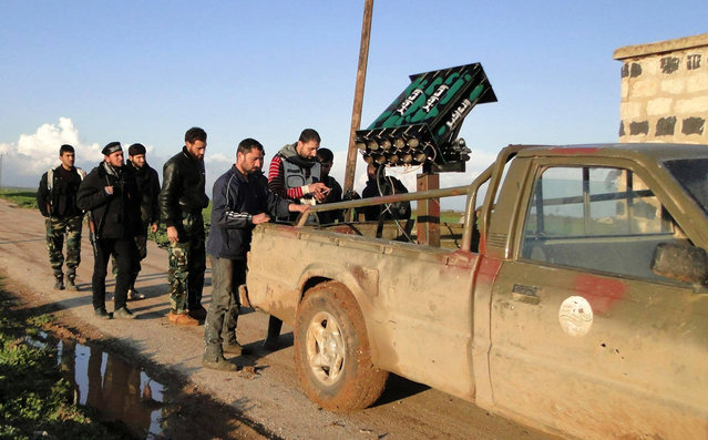 Free Syrian Army fighters stand beside a locally made anti-aircraft weapon near the Menagh military airport in Aleppo's countryside, on February 17, 2013. (Photo by Mahmoud Hassano/Reuters)