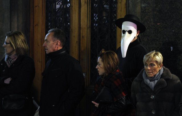 People wait for the start of the Carnival parade in Gijon, northern Spain, February 17, 2015. (Photo by Eloy Alonso/Reuters)