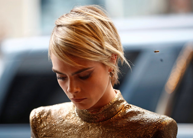 """A bee flies near Cara Delevingne as she arrives at the world premiere of """"Her Smell"""" at the Toronto International Film Festival (TIFF) in Toronto, Ontario, Canada September 9, 2018. (Photo by Mark Blinch/Reuters)"""