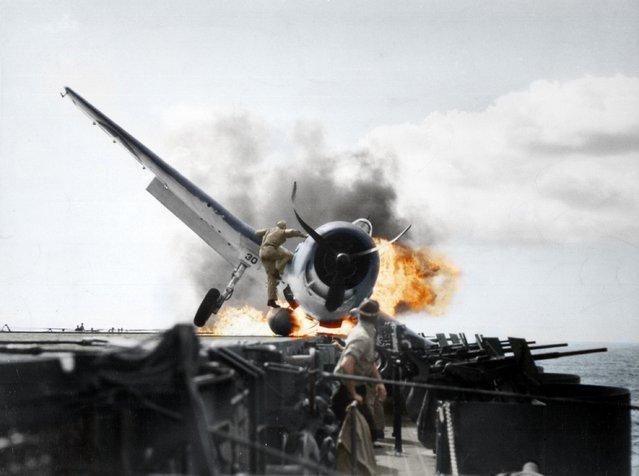 Crash landing of a F6F-3 (Hellcat) onto USS Enterprise (CV-6), Pacific Ocean, 1943.