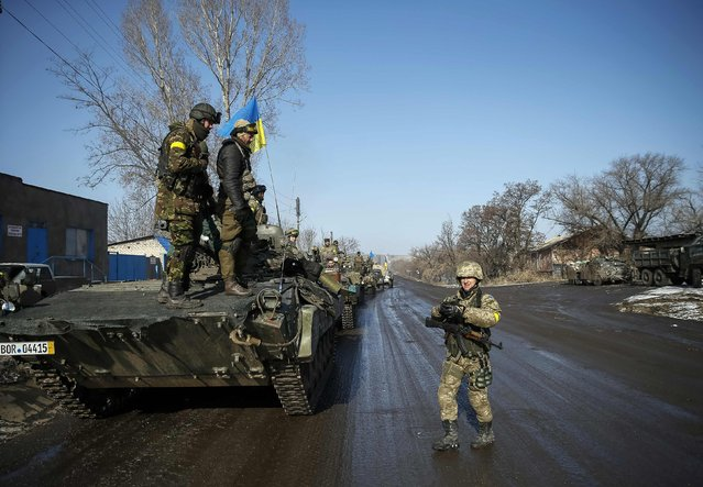 Members of the Ukrainian armed forces stand on an armoured personnel carrier (APC) near Debaltseve, eastern Ukraine, February 12, 2015. (Photo by Gleb Garanich/Reuters)