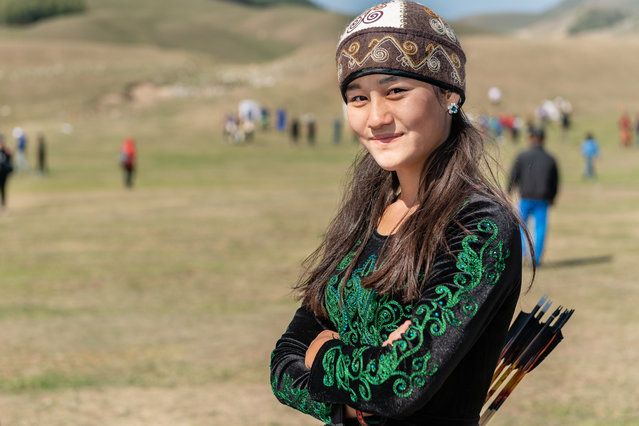 """Ayana Rustam, 16, from Kyrgyzstan, is the youngest female archer at the World Nomad Games. This is her first competition, and she was drawn into the sport by simple curiosity. She says a challenge she faces as a woman is that there are different thoughts that come to her head, and she must learn to overcome those to win. After high school, she plans to pursue studies in law to """"defend others and fight for justice"""". (Photo by Eleanor Moseman/The Guardian)"""
