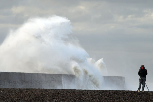 High winds, heavy and stormy seas batter the Newhaven lighthouse and harbour in East Sussex, United Kingdom on May 4, 2021. (Photo by Martin Dalton/Rex Features/Shutterstock)