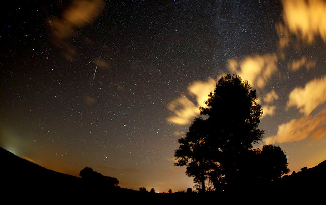 Meteors streak past stars in the night sky during the Perseid meteor shower in Premnitz, west of Berlin, Germany, August 11, 2018. (Photo by Fabrizio Bensch/Reuters)