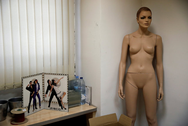 A mannequin stands in a textile factory in Madrid, Spain May 19, 2014. (Photo by Andrea Comas/Reuters)