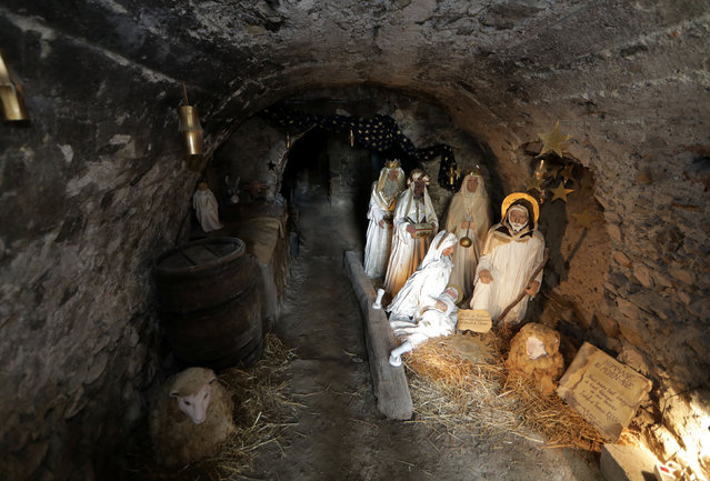 A Nativity scene is seen in a cellar in the medieval mountain village of Luceram as part of Christmas holiday season, France, December 15, 2016. (Photo by Eric Gaillard/Reuters)