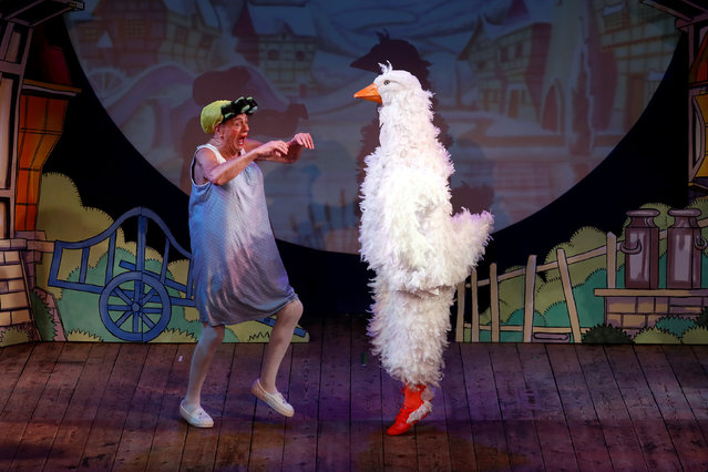 """Actor Roy Hudd (L) plays the pantomime dame role of Mother Goose during a performance of """"Mother Goose"""" at Wilton's Music Hall in London, Britain December 9, 2016. (Photo by Stefan Wermuth/Reuters)"""