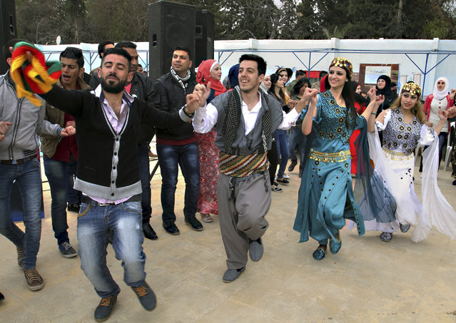Syrian Kurds dance to celebrate Nowruz, the Kurdish new year, in Damascus, Syria, Saturday, March 21, 2015. (Photo by AP Photo)