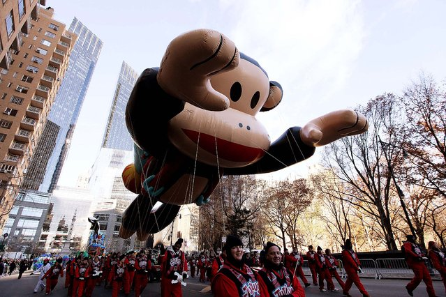 Julius the Monkey passes near Columbus Circle. (Photo by Hiroko Masuike/The New York Times)