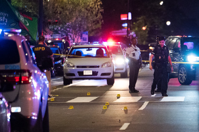 Shell casings dot 14th St NW after a shooting sent diners lining the popular street running for cover in Washington, DC, on July 22, 2021. (Photo by Craig Hudson for The Washington Post)