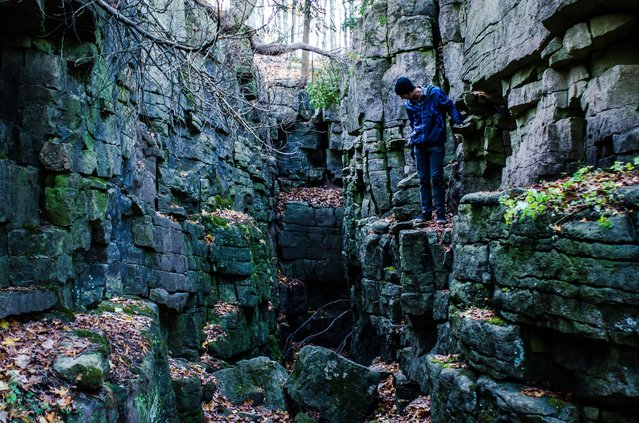 """Into the void"". Found this fissure while hiking with my brother one day, and scaled down into it and explore around. Photo location: Kelso Cliffs, Ontario, Canada. (Photo and caption by Dan Sedran/National Geographic Photo Contest)"