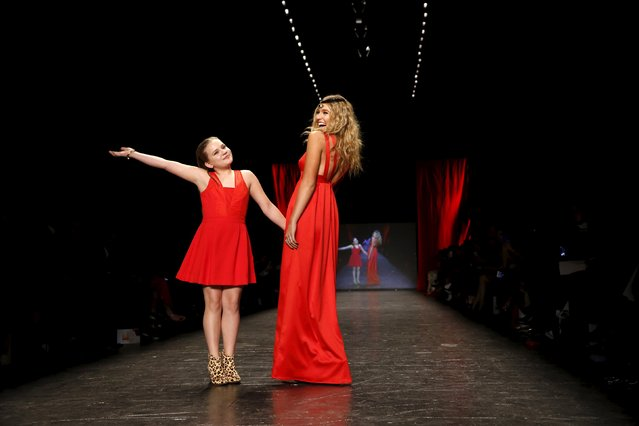 Maisy and Lennon Stella present a creation during the American Heart Association's (AHA) Go Red For Women Red Dress Collection, presented by Macy's at New York Fashion Week February 11, 2016. (Photo by Andrew Kelly/Reuters)