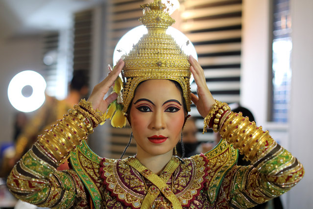 A dancer poses backstage before a performance of masked theatre known as Khon which was recently listed by UNESCO, the United Nations' cultural agency, as an intangible cultural heritage, along with neighbouring Cambodia's version of the dance, known as Lakhon Khol at the Thailand Cultural Centre in Bangkok, Thailand November 7, 2018. (Photo by Jorge Silva/Reuters)