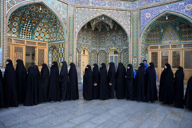 Iranian women stand in line at a polling station during the parliamentary and Experts Assembly elections in Qom, 125 kilometers (78 miles) south of the capital Tehran, Iran, Friday, February 26, 2016. Iranians were voting on Friday in parliamentary elections, the country's first since its landmark nuclear deal with world powers last summer. (Photo by Ebrahim Noroozi/AP Photo)