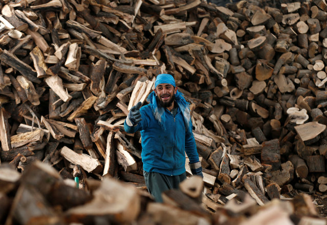 An Afghan man works at his firewood stall in Kabul, Afghanistan January 5, 2017. (Photo by Mohammad Ismail/Reuters)