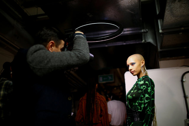 A model poses backstage of the House of Holland catwalk show during London Fashion Week Women's A/W19 in London, Britain February 16, 2019. (Photo by Henry Nicholls/Reuters)