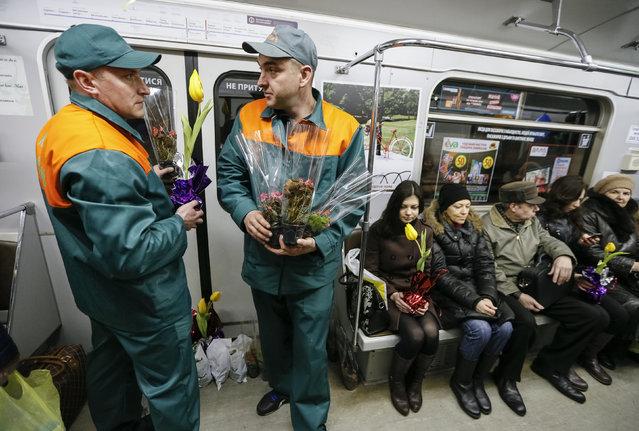 Kiev's subway staff waits for female passengers in order to offer them flowers ahead of International Women's Day in Kiev, Ukraine, March 2, 2016. (Photo by Gleb Garanich/Reuters)