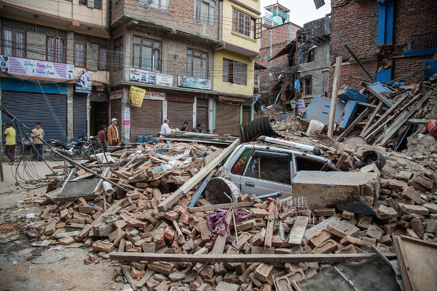 A taxi is buried under debris from a collapsed building in Thamel following an earthquake on April 25, 2015 in Kathmandu, Nepal. (Photo by Omar Havana/Getty Images)